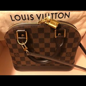 💯% Authentic Louis Vuitton 👝💖
